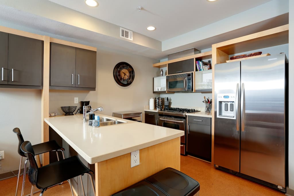 Gourmet kitchen, solid countertop and stainless steel appliances.