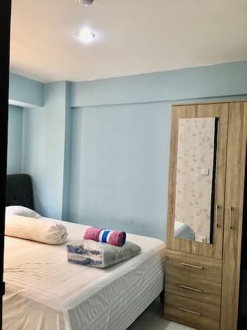 First bedroom with queen beds