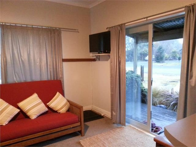Lounge has Log Fire and TV with double doors to deck.