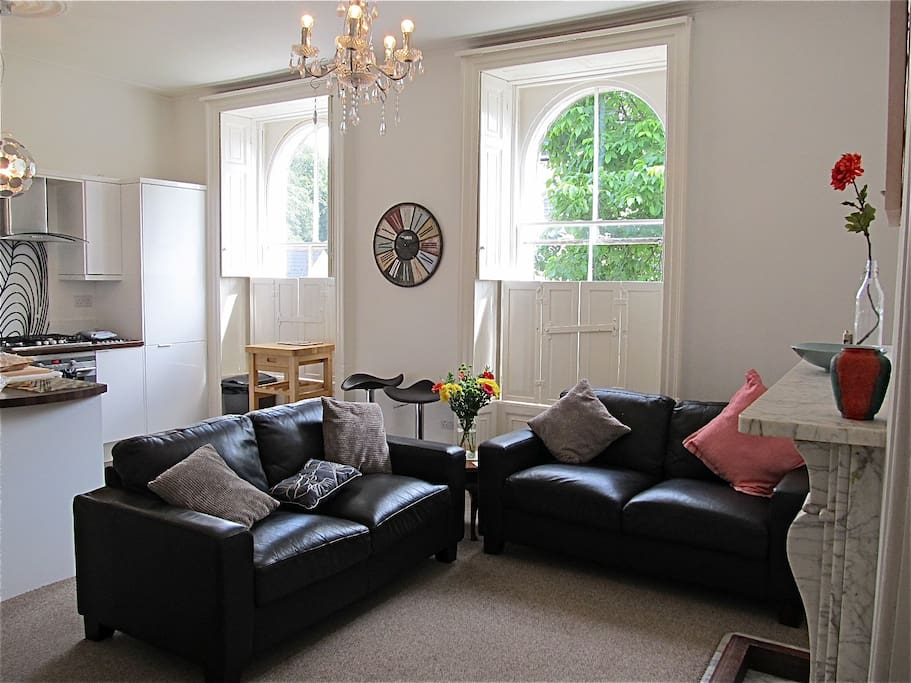 This stylish and private apartment peacefully overlooks the garden.