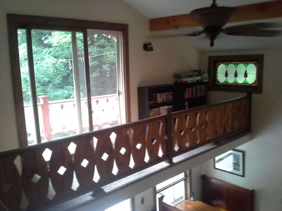 The upstairs cat walk and porch, plus two bookshelves full  of books and DVDs for guests to enjoy.
