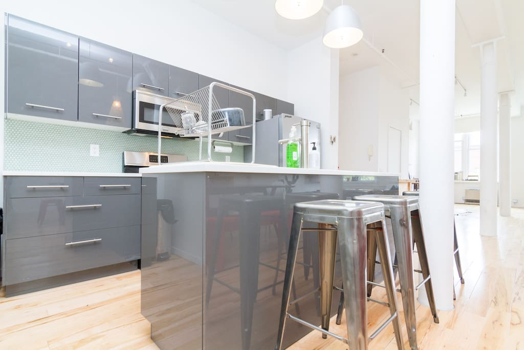 large open dining area with cooking island and tolix stools