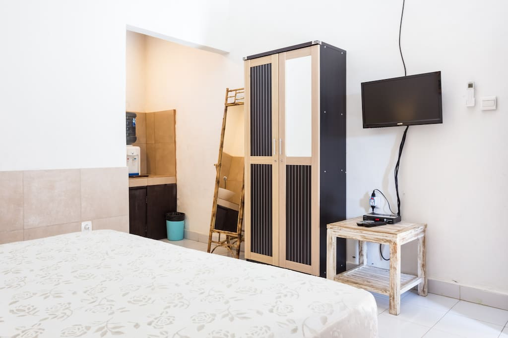 Flat-Screen TV with Free satellite Channels, Closet, Full Length Mirror, New Comfortable Queen Bed, Large Window, Bedside Tables, Rattan Lamps. Local Balinese Artwork. Daily Cleaning is included. Toilet Paper and Soap are also included.