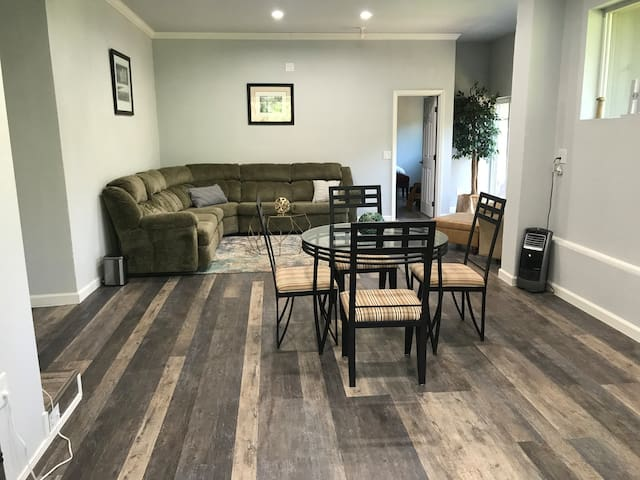 Living room with sectional couch and sofa sleeper