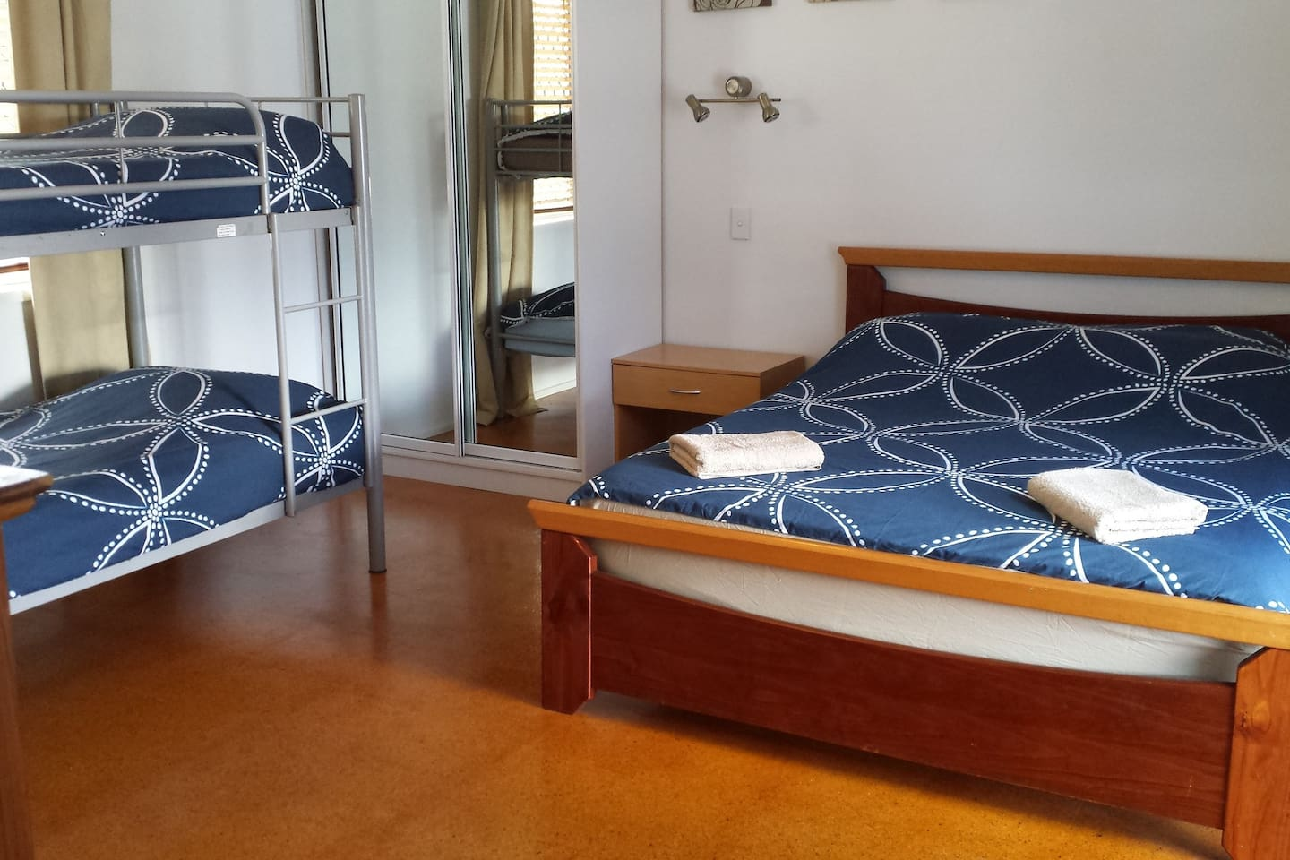 large spacious bedroom with en-suite, leading onto private balcony.