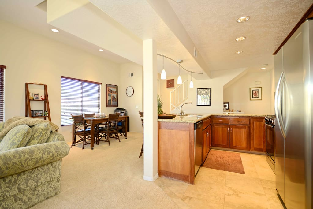 Open living room with kitchen & dining area