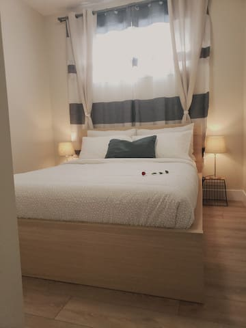 A beautiful bedroom with a queen size bed made for your comfort.