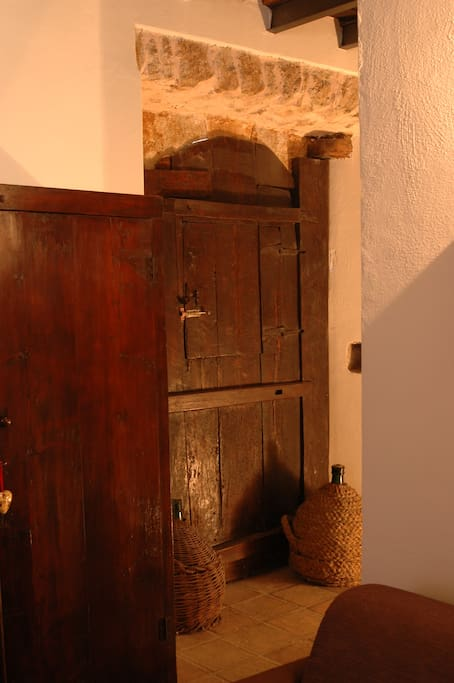 The antique doorway from the '700s, artfully refurbished,