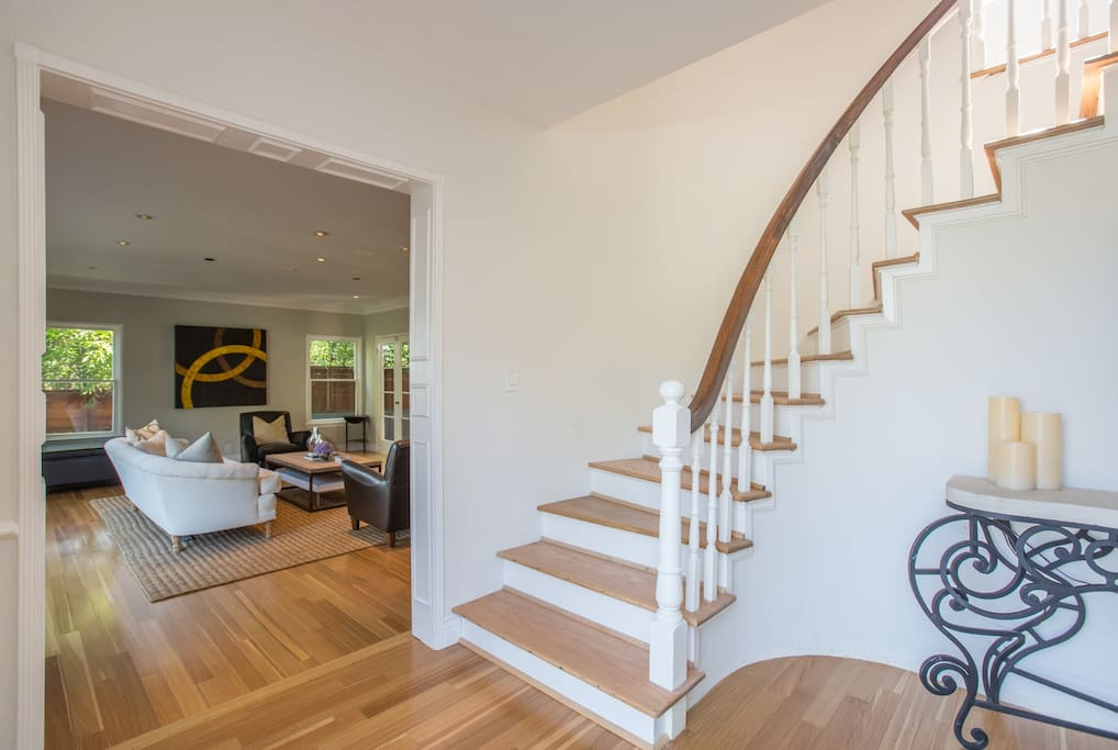 front entry way with stairs leading up to all 3 bedrooms.
