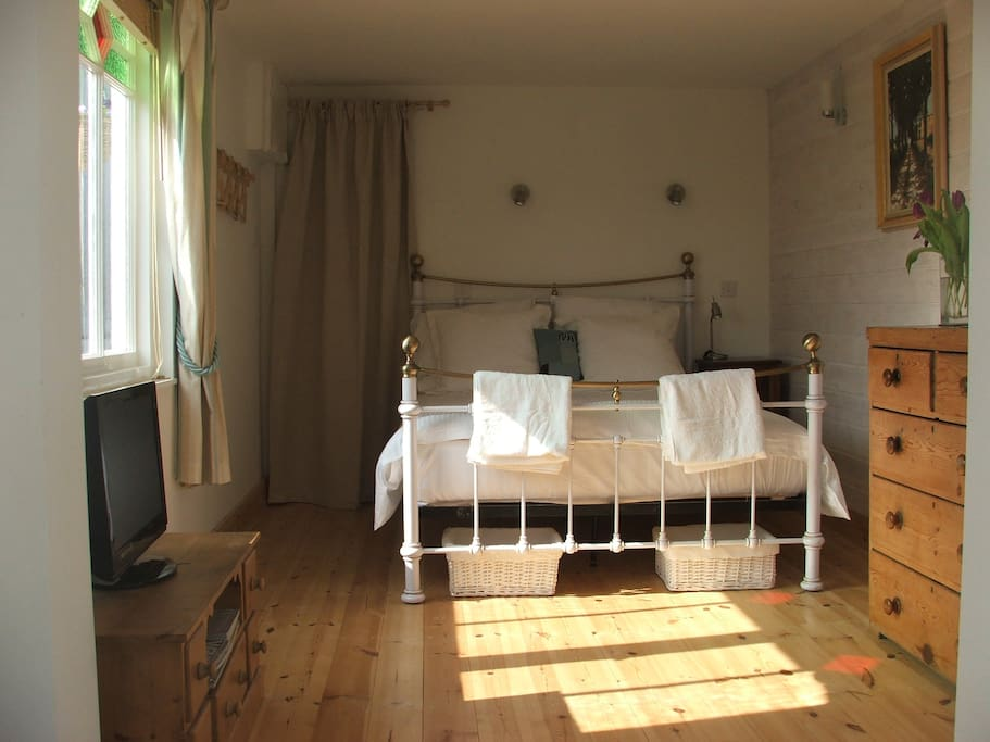 Bedroom with the morning light creeping across the floor