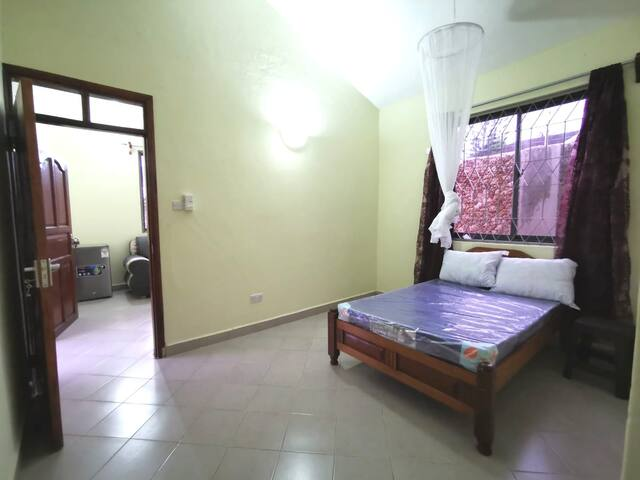 The bedroom with mosquito net.