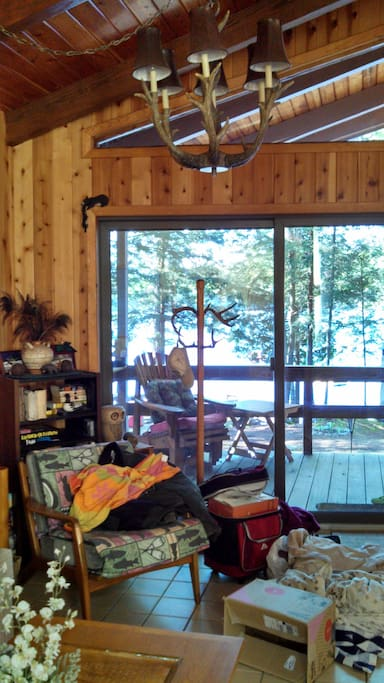 Looking out from the living room over the deck to the lake