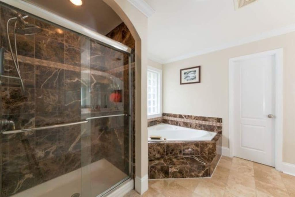 Jaccuzi with standup shower in master bedroom.