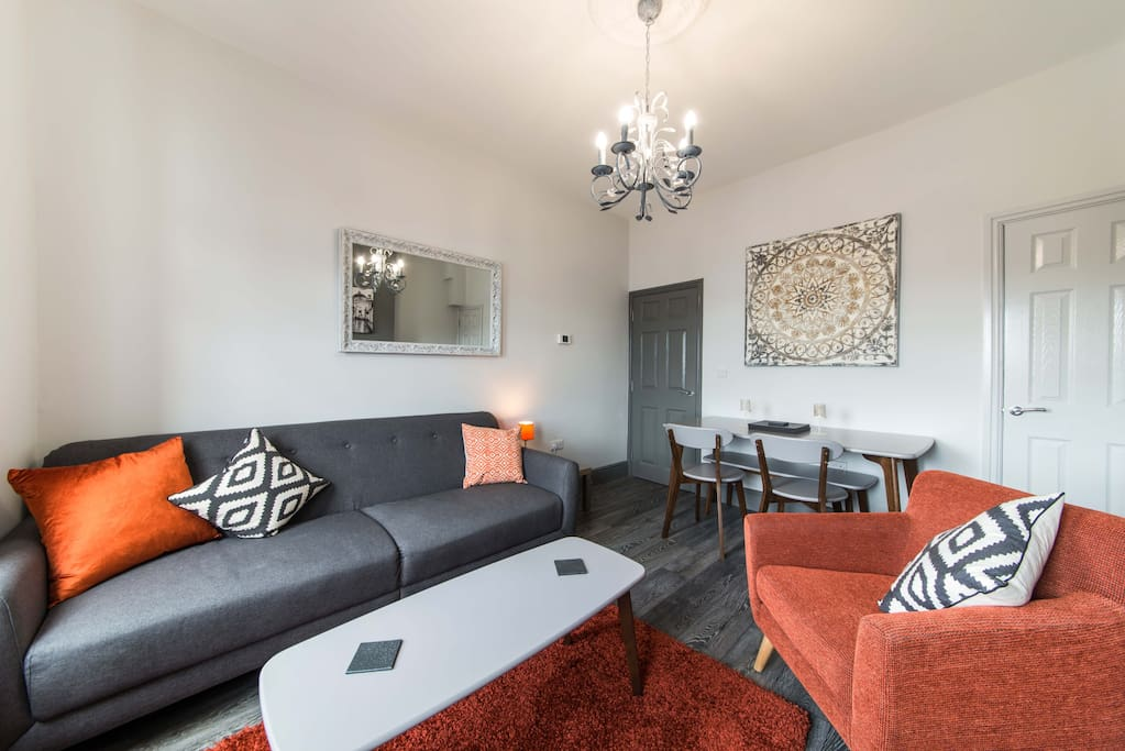 Lounge in 2 bed duplex Apartment with Netflix