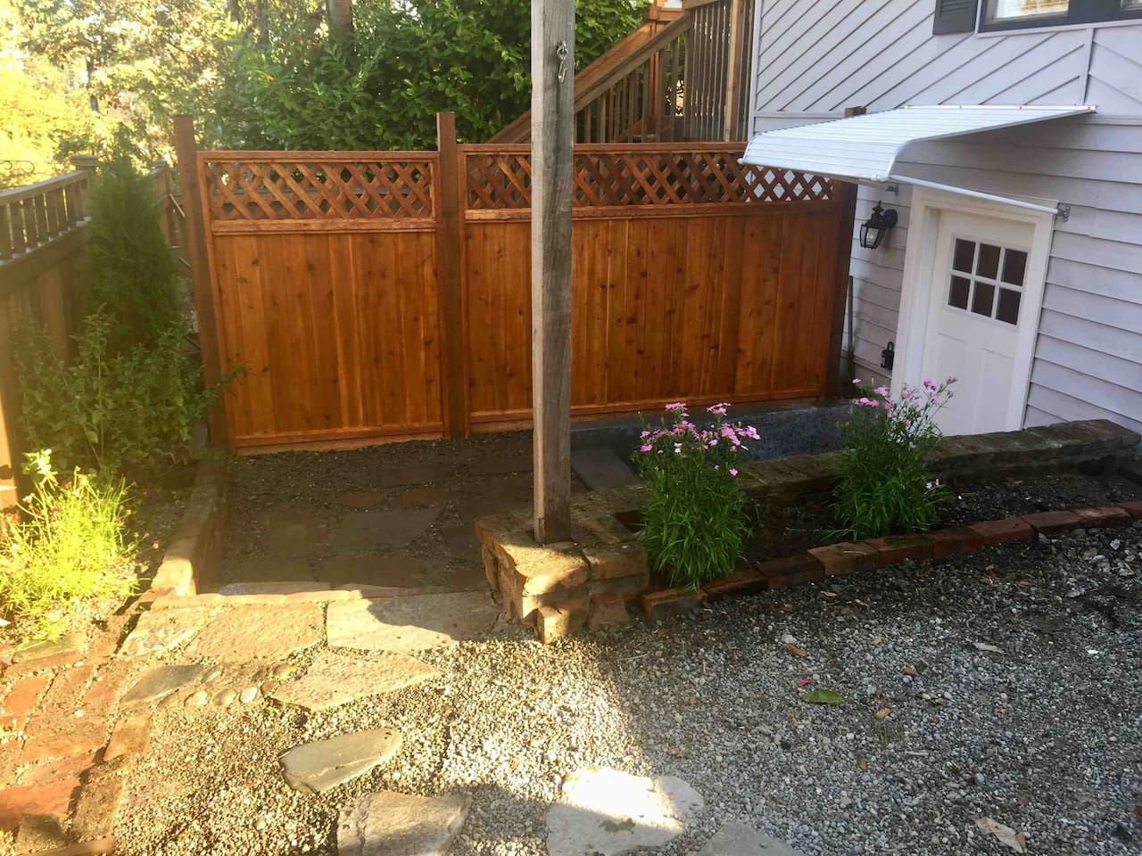 private entrance and patio in enclosed side yard