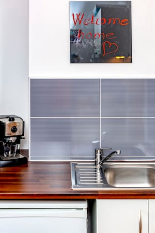 Fully equipped kitchen with esspresso maker fridge, freezer, cooktop, microwave, toaster and kettle