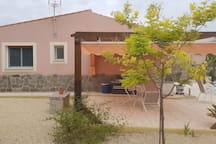 The pergola and side view of the casita.  Here you see the en-suite and the main bedroom windows.