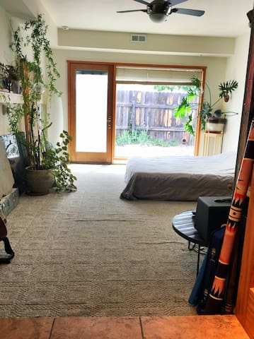 Abundant light and a large window with a separate entrance leading directly to the  driveway front of the property.