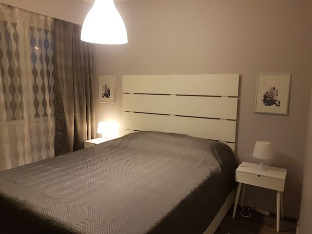 Bedroom with large 160-sm double bed and a wardrobe.