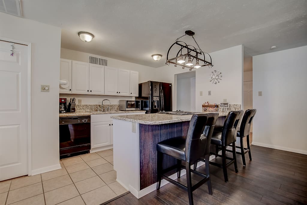 Remodeled kitchen with bar seating.