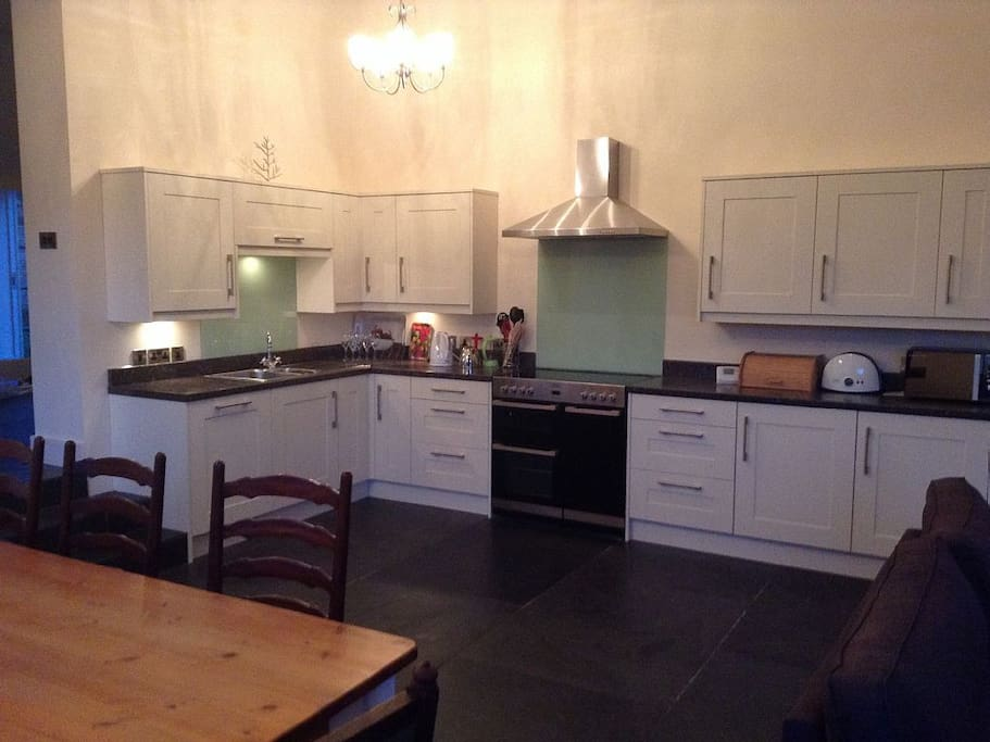 Kitchen area, fully equipped with cooker, fridge, freezer, toaster, crockery, cutlery etc