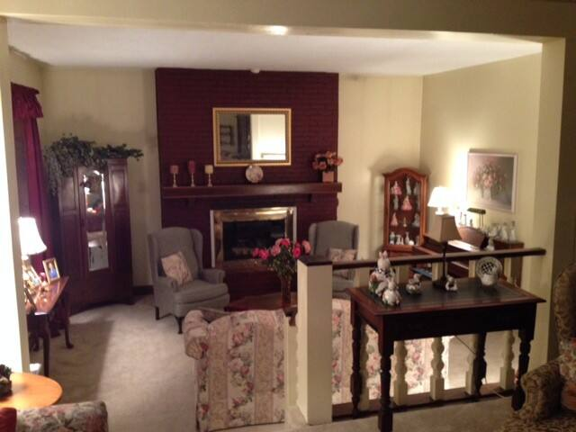 The living room with fireplace, one of several areas available for your use.