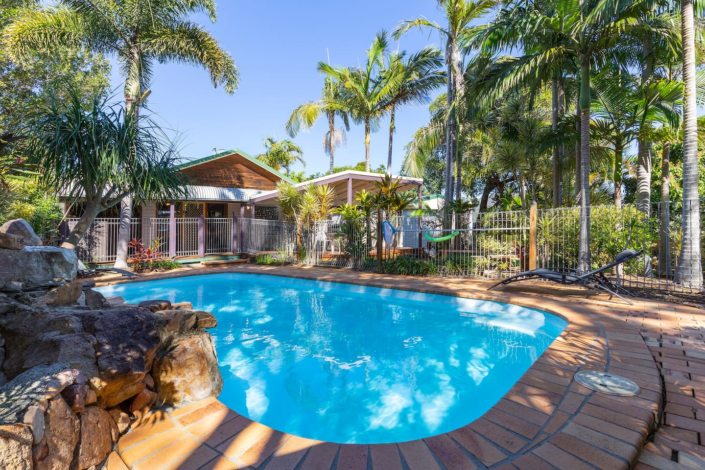 This large, spacious four bedroom Beach house is located in an elevated position and perfectly located just 800 metres to local beaches. The property provides a private rear deck area, overlooking the in-ground saltwater pool & fully fenced rear yard area. You can just relax in the peaceful, quiet surrounds and enjoy the soothing ocean breezes and sounds of local birdlife. The property is Pet Friendly.