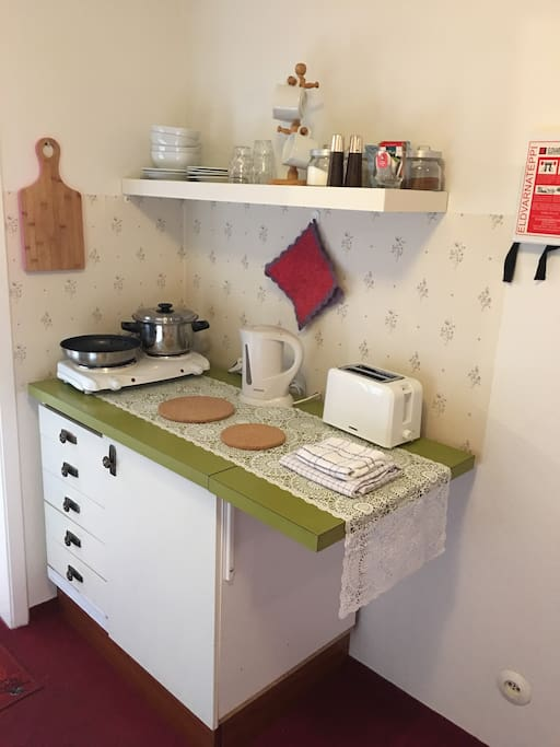 Fully equipped Kitchenette with hotplate, kettle, toaster, microwave and a small fridge.