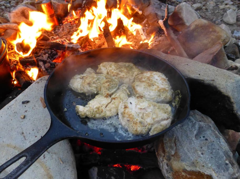 Prepare dinner over the campfire or on the propane camp stove.