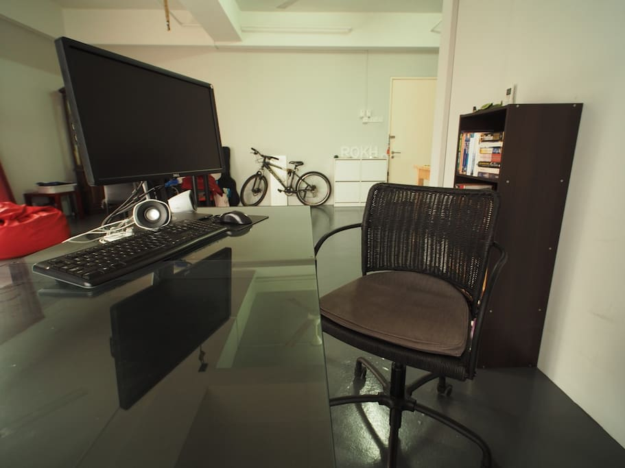 Working table with LCD monitor, keyboard and speakers for your use.