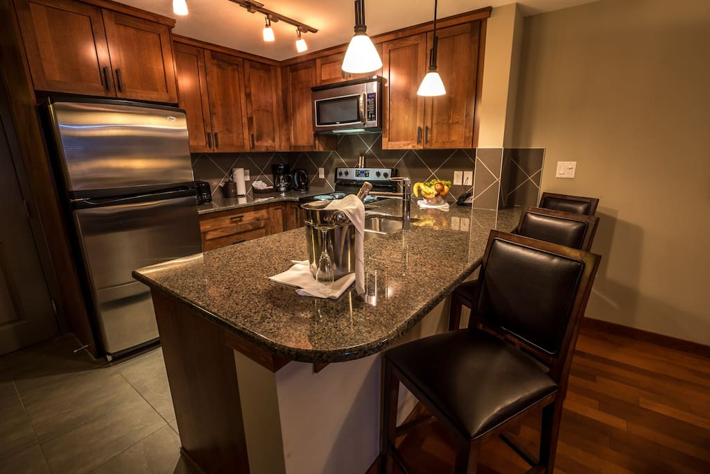 Chefs will love this modern kitchen with stainless steel appliances.