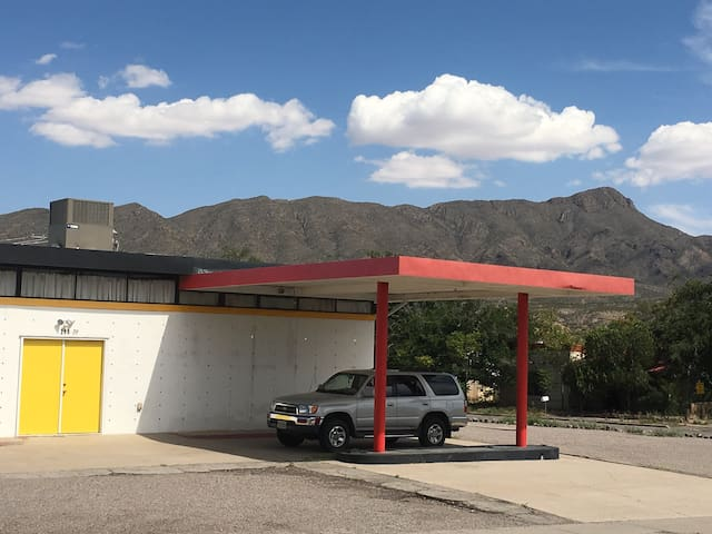 "SPACE CASTLE: We converted a 1950's gas station into a Space Castle in the center of the Hot Spring district in downtown T or C, NM. Experience our ""other worldly"" Art Theme Extravaganza home, with 12' high art appointed rooms, and an Outside Wonderland, ideal for pets, with tub and grill. Space Castle is within a few minutes walk from restaurants, soaking, Riverbend Hotsprings. This magical landscape invites hiking to the top of TurtleBack Mountain or along the Rio Grande River, or just take a trip inside our Castle. All Art is by Shaman Artist Q."