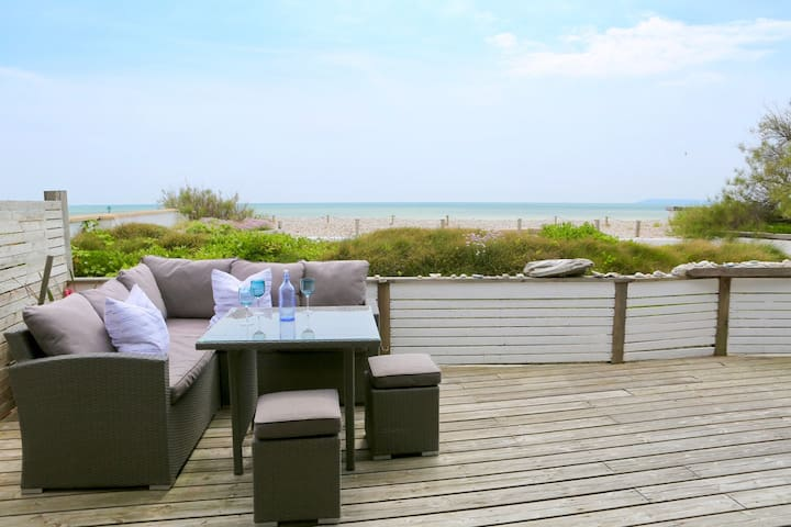 The extensive decking area with the sea beyond!