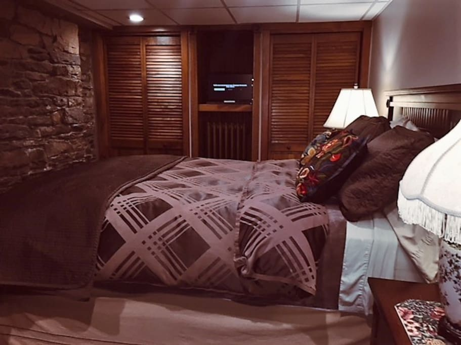 The Master Bedroom has a queen size bed and 2 cedar lined closets and a flat screen smart TV/Netflix