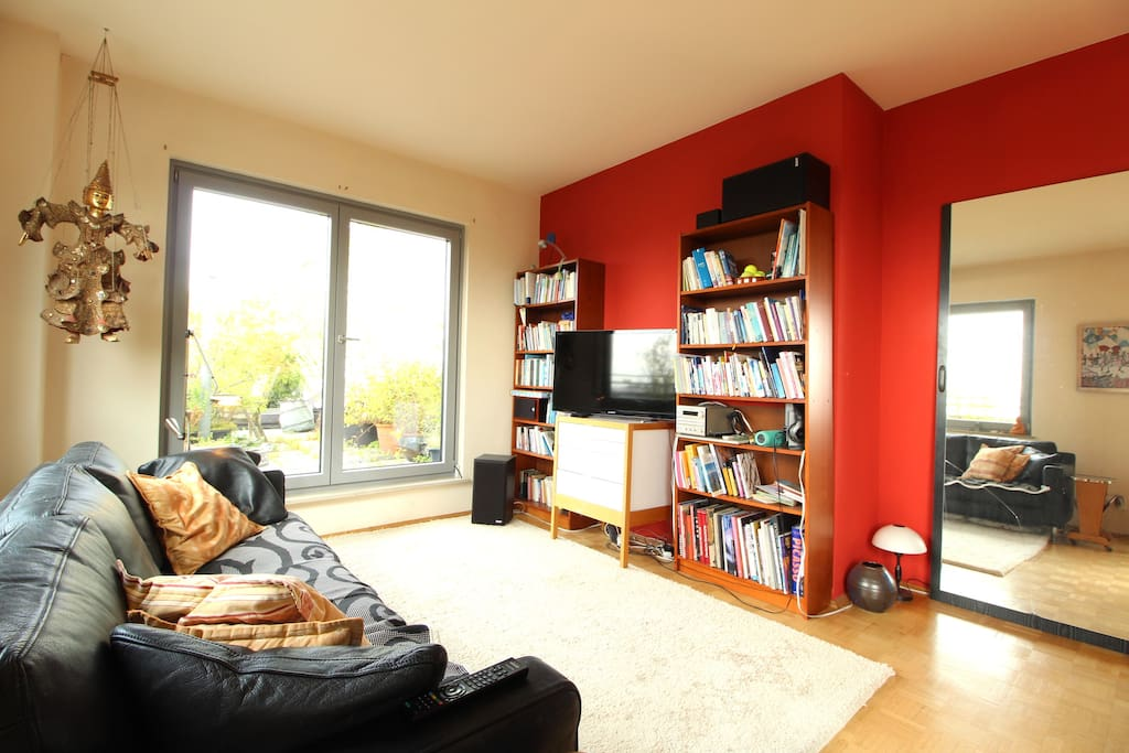 In the bright living room you can lay down and relax, read some book or watch TV.
