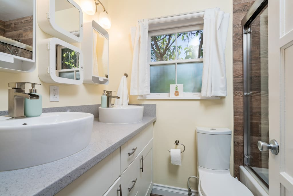 Main House Bathroom No. 2 with Double Sinks, Tub and Shower Combo