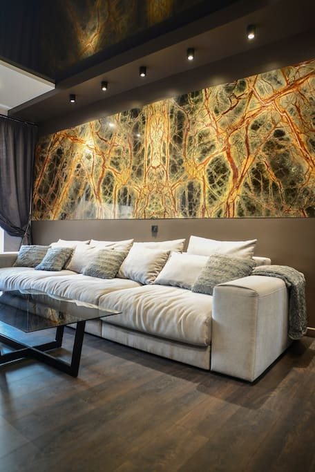 Stunning spacious living room welcomes you with large comfortable sofa, big screen TV with the satellite, free Wi-Fi access and air conditioner.