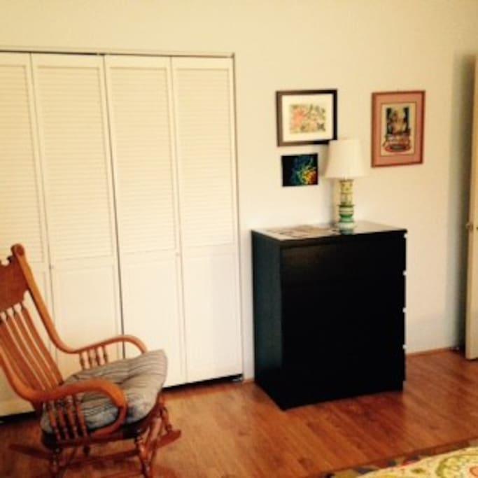 Wood floors, queen-size bed, full closet.