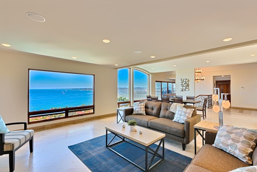Living room with large picture windows and a gorgeous ocean view!