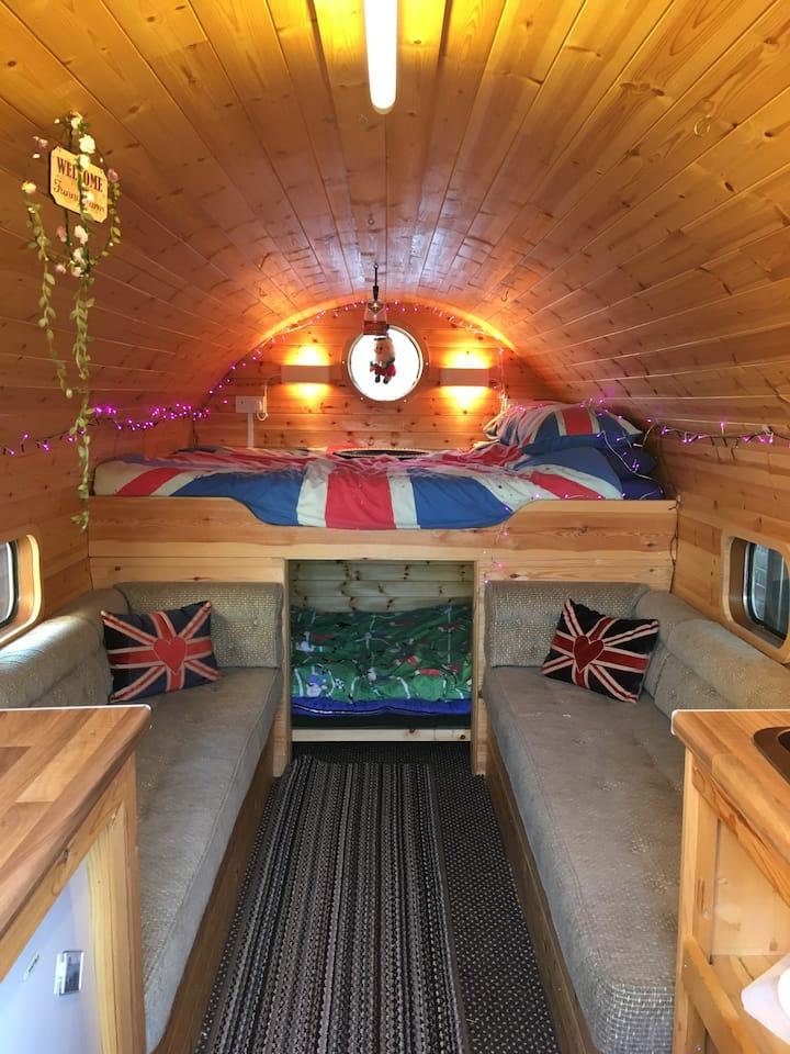 Wooden barrel caravan