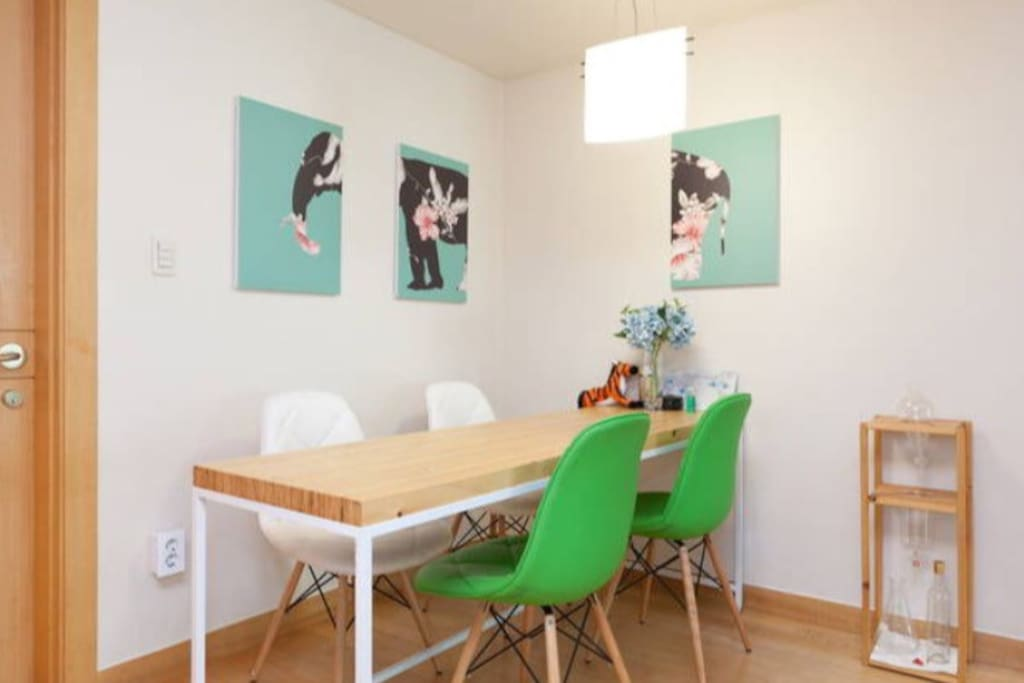 Dining table with art work , can seat up to 4 people