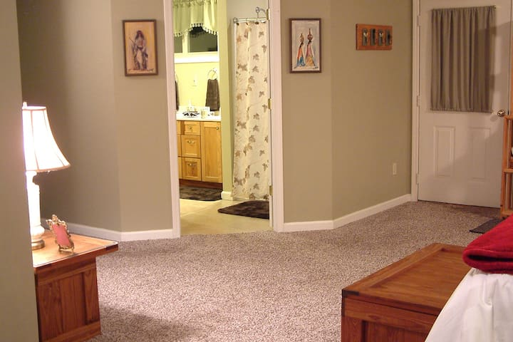 The main room to the private bathroom.