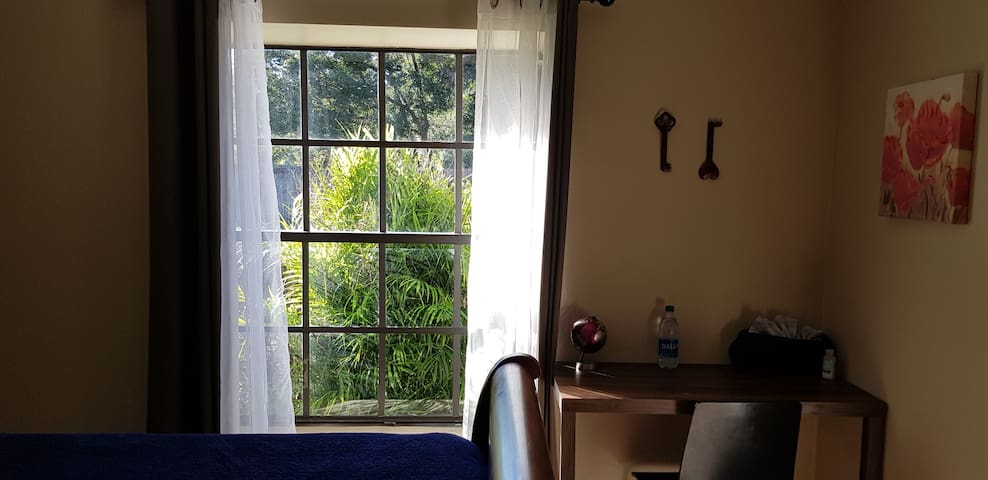 There is a desk in the room and a window ledge that serves as a nice reading area or an extra seat.  The westerly sunlight shining in the window and the garden view make the room dreamy.