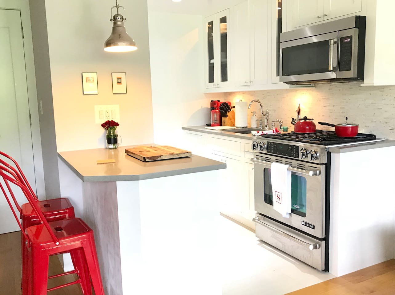 Gorgeous state-of-the-art kitchen with stainless steel appliances, gas stove, dishwasher, and microwave
