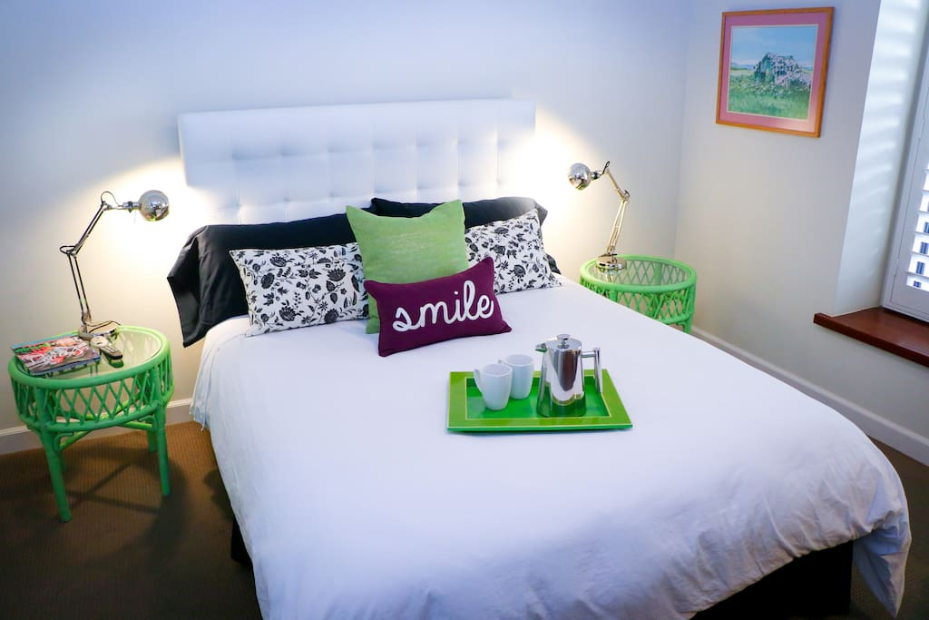 Primary guest room with queen bed for single or couple