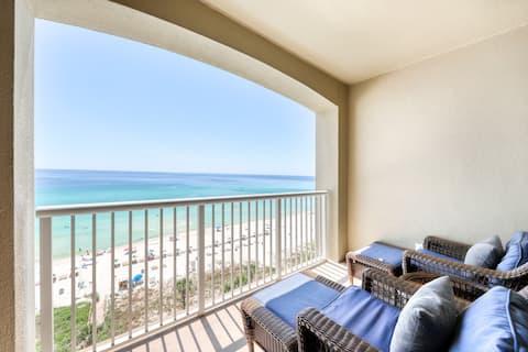 Beachfront condo rental w/ a private balcony plus shared pools, a hot tub, & gym