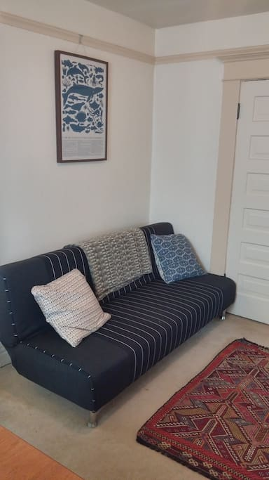 This additional futon in the living room pulls out to sleep up to two more travellers