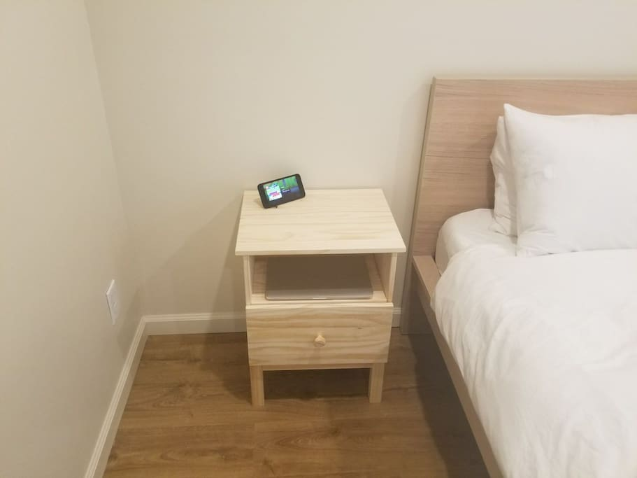 Bedroom Number 1. A side table for your side things. The lights in the room are dimable LED's that you can use to set the mood.