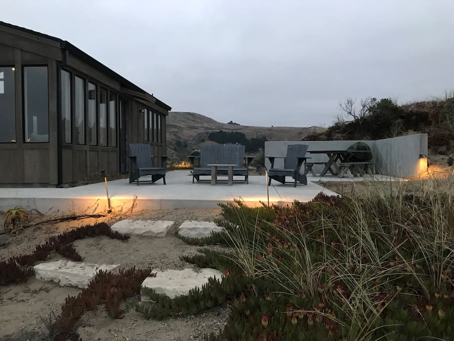 Patio at dusk with path to beach