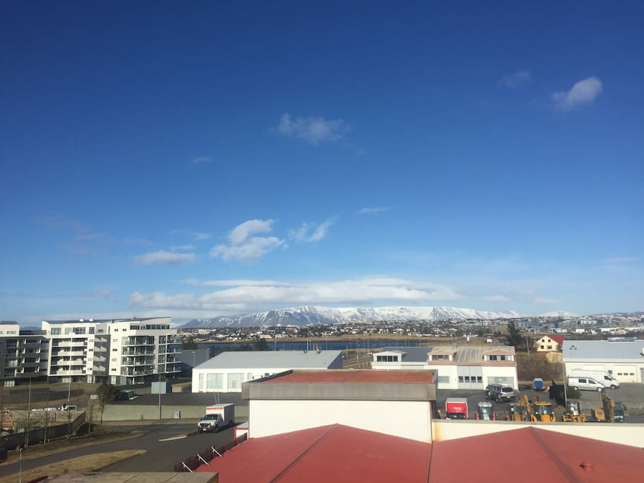 Spectacular view of the great Reykjavik , ocean and the Esja Mountains.